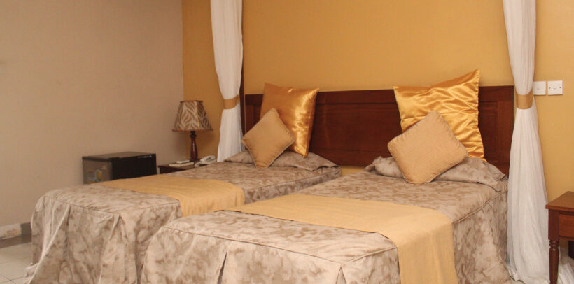 Image showing the arrangement of a room having twin beds at Mombasa Sports Club.